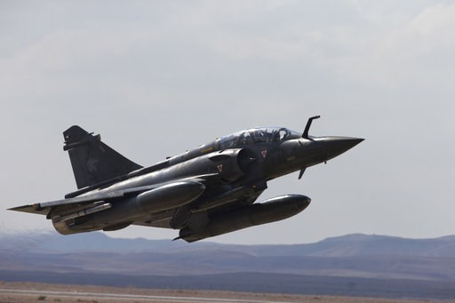 (AP Photo/Ariel Schalit, File). FILE - In this Wednesday, Nov. 8, 2017 file photo, a French Mirage 2000D jet fighter takes off from Ovda airbase near Eilat, southern Israel, during the 2017 Blue Flag exercise. A French fighter jet carrying two pilots h...