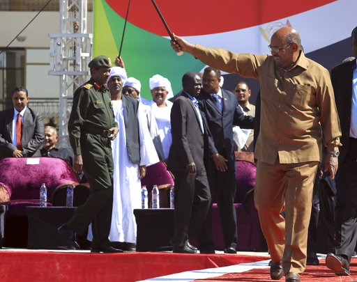 "(AP Photo/Mahmoud Hjaj). Sudan's President Omar al-Bashir greets his supporters at a rally in Khartoum, Sudan, Wednesday, Jan. 9, 2019. Al-Bashir told the gathering of several thousands of supporters in the capital that he is ready to step down only ""t..."