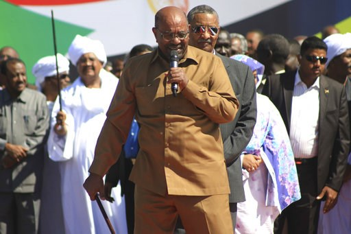 "(AP Photo/Mahmoud Hjaj). Sudan's President Omar al-Bashir addresses supporters at a rally in Khartoum, Sudan, Wednesday, Jan. 9, 2019. Al-Bashir told the gathering of several thousands of supporters in the capital that he is ready to step down only ""th..."