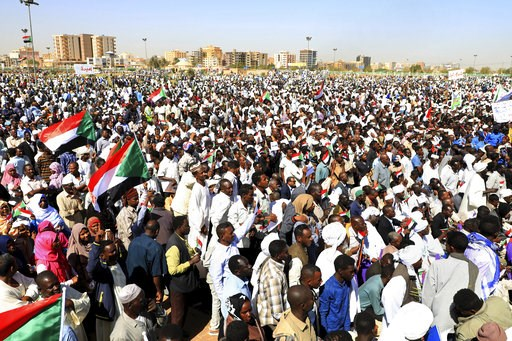 (AP Photo/Mahmoud Hjaj). Supporters of Sudan's President Omar al-Bashir attend a pro-government rally in Khartoum, Sudan, Wednesday, Jan. 9, 2019. Al-Bashir told the gathering of several thousands of supporters in the capital that he is ready to step d...