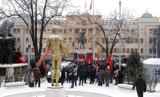 (AP Photo/Boris Grdanoski). Opponents to the change of the country's constitutional name protest outside the parliament building prior to a session of the Macedonian Parliament in the capital Skopje, Wednesday, Jan. 9, 2019. Macedonian lawmakers are en...