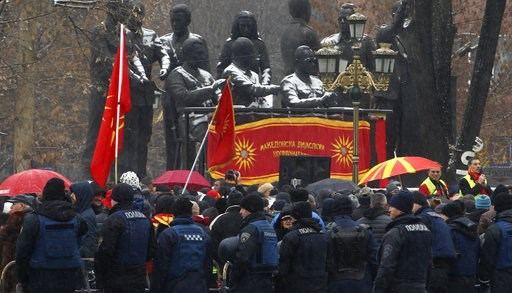 (AP Photo/Boris Grdanoski). Police stand guard during a protest against the change of the country's name outside the parliament building in Skopje, Macedonia, Wednesday, Jan. 9, 2019. Macedonian lawmakers are entering the last phase of debate on consti...