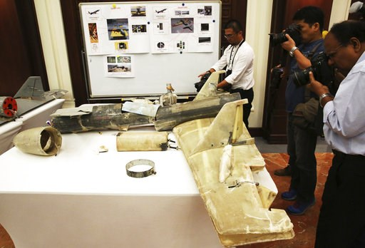 (AP Photo/Jon Gambrell, File). FILE - In this June 19, 2018 file photo, photographers take pictures of what U.A.E. officials described as an Iranian Qasef drone captured on the battlefield in Yemen during a news conference in Abu Dhabi, United Arab Emi...