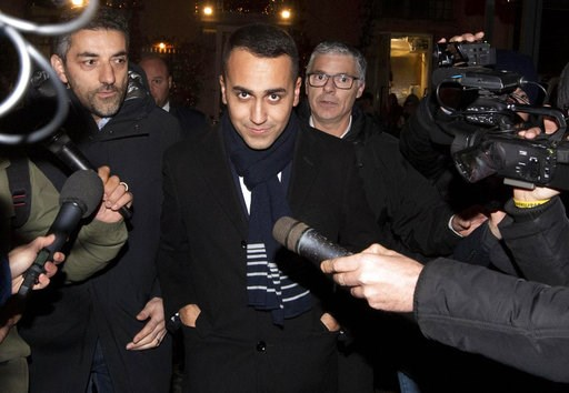 (Claudio Peri/ANSA via AP). In this photo taken on Wednesday, Jan. 9, 2018, Italian Deputy Premier Luigi Di Maio leaves a restaurant in Rome. An Italian government leader says his populist movement is ready to help anti-government protesters in France....