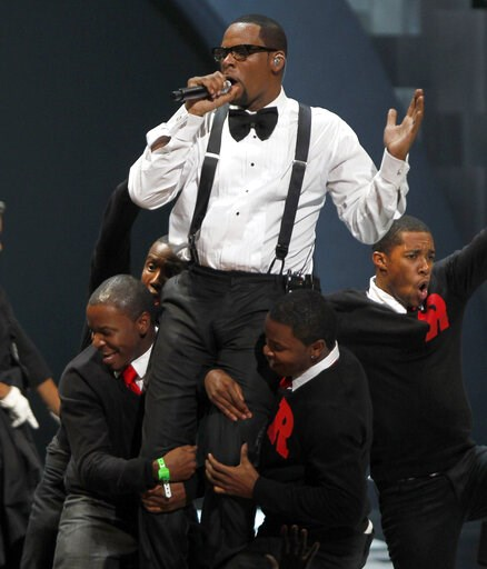 "(AP Photo/David Goldman, file). FILE - In this Nov. 10, 2010 file photo, singer R. Kelly performs ""When A Woman Loves,"" during the Soul Train awards in Atlanta. Kelly, one of the top-selling recording artists of all time, has been hounded for years by ..."