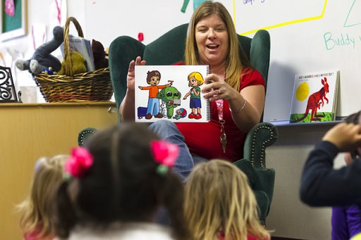 (Nelvin C. Cepeda/The San Diego Union-Tribune via AP, File). FILE - In this Feb. 13, 2015 file photo, Lakeside preschool teacher Nicki Fisher reads a story about an alien to her class as part of a Harmony Program lesson on possibilities and empathy, in...