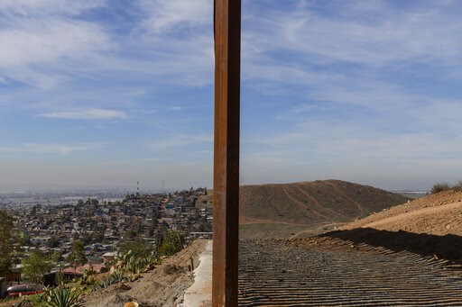 (AP Photo/Daniel Ochoa de Olza). FILE - This Saturday, Dec. 22, 2018 file photo shows Tijuana, Mexico, left, and San Diego, Calif., separated by a U.S. border fence. The partial government shutdown which started in December 2018 has furloughed hundreds...