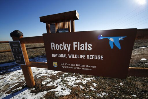 (AP Photo/David Zalubowski,File). FILE - In this Nov. 18, 2018, file photo, a sign marks a trailhead at the Rocky Flats National Wildlife Refuge in Broomfield, Colo., outside Denver. Activists are asking a judge to unseal documents from a 27-year-old c...