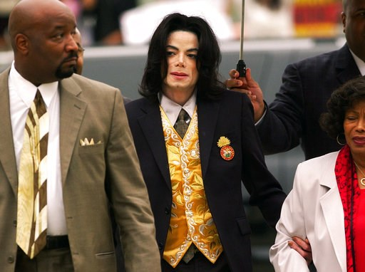 (Aaron Lambert/Santa Maria Times via AP, Pool). FILE - In this May 25, 2005 file photo, Michael Jackson arrives at the Santa Barbara County Courthouse for his child molestation trial in Santa Maria, Calif. A documentary film about two boys who accused ...