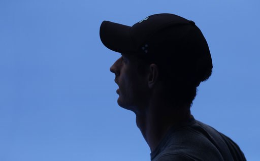 (AP Photo/Mark Baker). Britain's Andy Murray waits in the shade during his practice match against Serbia's Novak Djokovic on Margaret Court Arena ahead of the Australian Open tennis championships IN Melbourne, Australia, Thursday, Jan. 10, 2019.