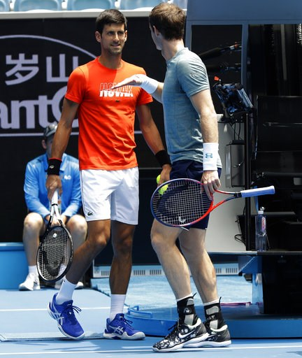 (AP Photo/Mark Baker). Britain's Andy Murray, right, gestures to Serbia's Novak Djokovic during a practice match on Margaret Court Arena ahead of the Australian Open tennis championships IN Melbourne, Australia, Thursday, Jan. 10, 2019.