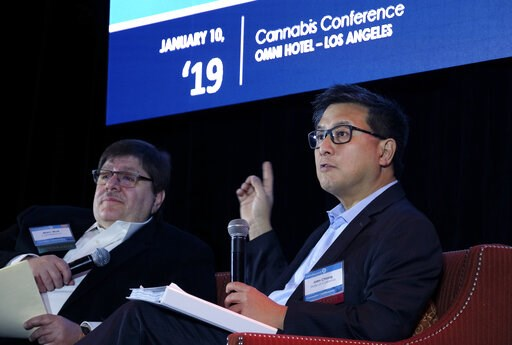 (AP Photo/Richard Vogel). Former California State Treasurer John Chiang, right, answers questions from moderator Marc Wolf, left, at the CohnReznick Cannabis Conference 2019 in downtown Los Angeles, Thursday, Jan. 10, 2019. Gov. Gavin Newsom's new budg...