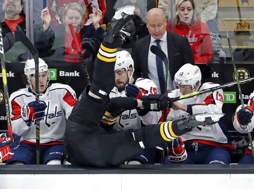 (AP Photo/Elise Amendola). Boston Bruins defenseman Zdeno Chara is checked into the Washington Capitals bench during the first period of an NHL hockey game Thursday, Jan. 10, 2019, in Boston.