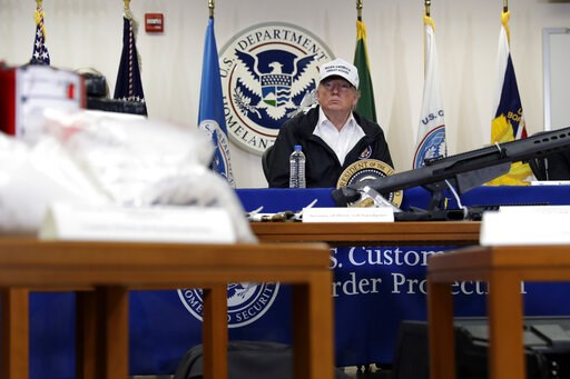 (AP Photo/ Evan Vucci). With illegal drugs and weapons displayed in the foreground, President Donald Trump speaks at a roundtable on immigration and border security at U.S. Border Patrol McAllen Station, during a visit to the southern border, Thursday,...