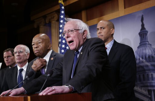 (AP Photo/J. Scott Applewhite). Sen. Bernie Sanders, I-Vt., center, joined from left by Sen. Richard Blumenthal, D-Conn., Rep. Peter Welch, D-Vt., Rep. Elijah Cummings, D-Md., and Sen. Cory Booker, D-N.J., speaks to reporters as he prepares to introduc...