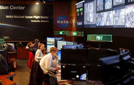 (AP Photo/David Goldman). Workers monitor research operations aboard the International Space Station from NASA's Payload Operations Integration Center in Huntsville, Ala., Wednesday, Jan. 9, 2019. Of the roughly 800,000 federal employees facing deferre...