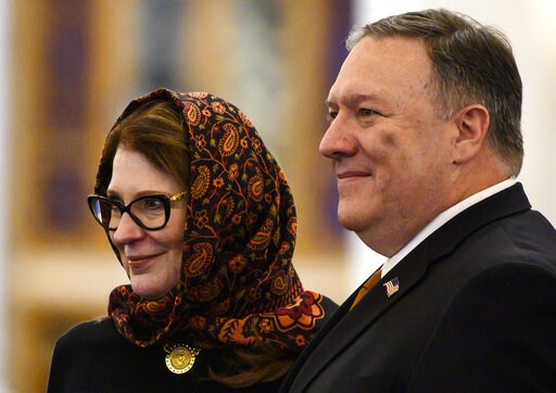 (Andrew Caballero-Reynolds/Pool Photo via AP). Secretary of State Mike Pompeo and his wife Susan pose for a photo as they tour the newly inaugurated Cathedral of the Nativity Christ, in Egypt's New Administrative Capital, east of Cairo, Thursday,  Jan....