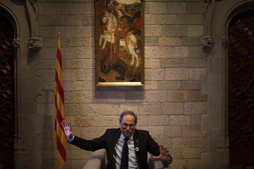 (AP Photo/Emilio Morenatti). In this Thursday, Jan. 10, 2019 photo, Catalan regional president Quim Torra speaks during an interview with the Associated Press, at the Palace of Generalitat or Catalan government headquarters, in Barcelona, Spain. Catalo...
