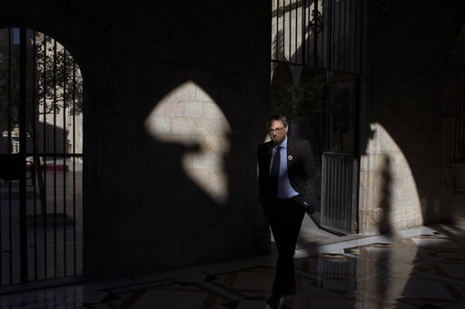 (AP Photo/Emilio Morenatti). In this Thursday, Jan. 10, 2019 photo, Catalan regional president Quim Torra walks at the Palace of Generalitat or Catalan government headquarters, ahead of an interview with The Associated Press, in Barcelona, Spain. Catal...