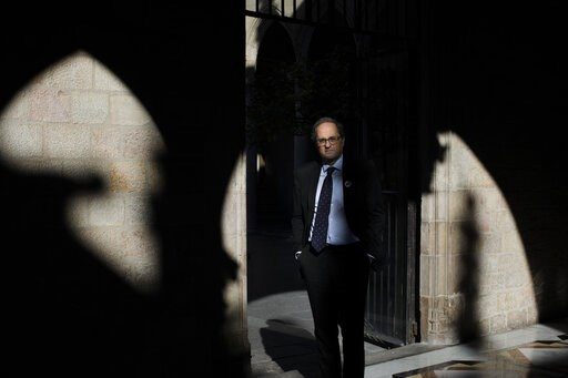 (AP Photo/Emilio Morenatti). In this Thursday, Jan. 10, 2019 photo, Catalan regional president Quim Torra poses for a photo at the Palace of Generalitat or Catalan government headquarters, ahead of an interview with The Associated Press, in Barcelona, ...