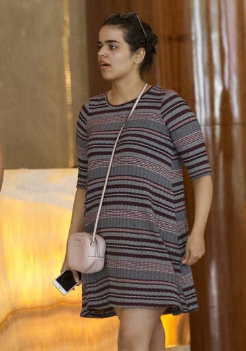 (AP Photo/Sakchai Lalit). Rahaf Mohammed Alqunun holds a mobile phone in Bangkok, Thailand, Friday, Jan. 11, 2019. Alqunun, the 18-year old Saudi woman who fled her family to seek asylum, remains in Thailand under the care of the U.N. refugee agency as...