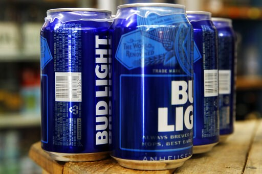 (AP Photo/Jacquelyn Martin). This Thursday, Jan. 10, 2019, photo shows cans of Bud Light in Washington. Starting next month, packages of Bud Light will have prominent labels showing the beer's ingredients and calories as well as the amount of fat, carb...
