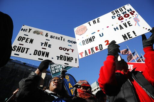 (AP Photo/Pablo Martinez Monsivais). Union members and other federal employees rally to call for an end to the partial government shutdown, Thursday, Jan. 10, 2019 at AFL-CIO Headquarters in Washington.