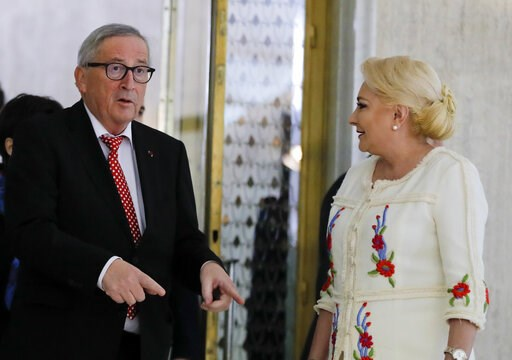 (AP Photo/Vadim Ghirda). European Union's Commission President Jean-Claude Junker, left, gestures as he meets Romanian Premier Viorica Dancila at the Victoria palace in Bucharest, Romania, Friday, Jan. 11, 2019 during a visit marking the official start...