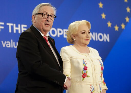 (AP Photo/Vadim Ghirda). European Union's Commission President Jean-Claude Junker, left, shakes hands with Romanian Premier Viorica Dancila at the Victoria palace in Bucharest, Romania, Friday, Jan. 11, 2019 during a visit marking the official start of...