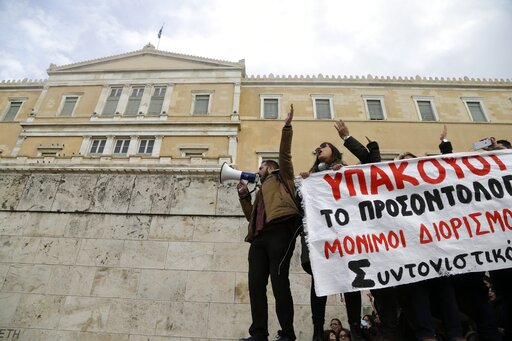 (AP Photo/Thanassis Stavrakis). Protesters shout slogans outside the Greek Parliament during a protest in Athens, Friday, Jan. 11, 2019. About 1,500 people took part in the protest. Teachers' unions oppose the government's selection process for the pla...