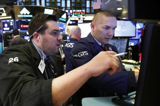 (AP Photo/Richard Drew). Trader Joseph Lawler, left, and specialist Mark Otto work on the floor of the New York Stock Exchange, Friday, Jan. 11, 2019. Stocks are opening broadly lower on Wall Street, led by declines in banks and technology companies.