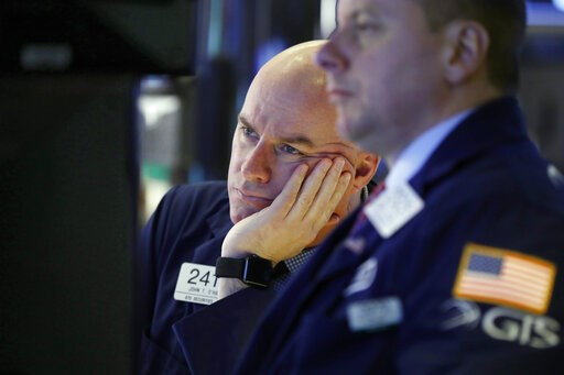 (AP Photo/Richard Drew). Specialist John O'Hara, left, works on the floor of the New York Stock Exchange, Friday, Jan. 11, 2019. Stocks are opening broadly lower on Wall Street, led by declines in banks and technology companies.