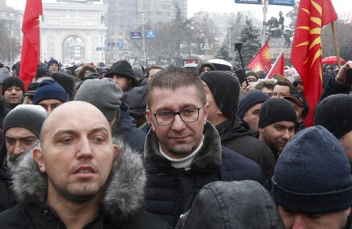(AP Photo/Boris Grdanoski). Hristijan Mickoski, center, leader of the opposition VMRO-DPMNE party, arrives to a protest against the change of the country's constitutional name, outside the parliament building prior a session of the Macedonian Parliamen...