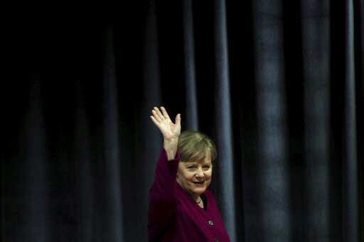 (AP Photo/Petros Giannakouris). German Chancellor Angela Merkel waves the students during her visit in a German school in Athens, Friday, Jan. 11, 2019. Merkel is widely blamed in Greece for the austerity that the country has lived through for much of ...