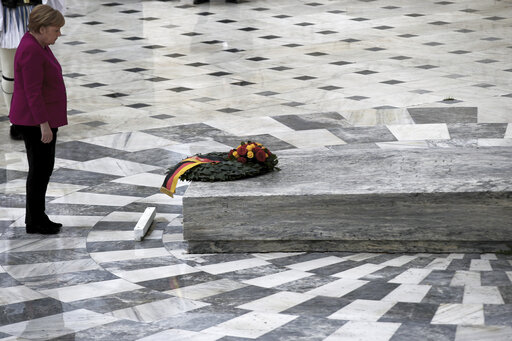 (AP Photo/Petros Giannakouris). German Chancellor Angela Merkel places a wreath at the monument of the Unknown Soldier during her visit in Athens, Friday, Jan. 11, 2019. Merkel is widely blamed in Greece for the austerity that the country has lived thr...