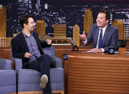 "(Andrew Lipovsky/NBCU Photo Bank via AP). This Oct. 4, 2016 image released by NBC shows Lin-Manuel Miranda during an interview with host Jimmy Fallon on ""The Tonight Show Starring Jimmy Fallon,"" in New York. Fallon's ""Tonight Show"" broadcast from Puert..."