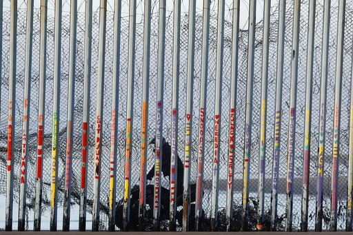 (AP Photo/Gregory Bull). A U.S. Border Patrol agent rides a vehicle on the beach in San Diego, Wednesday, Jan. 9, 2019, seen through the border wall from Tijuana, Mexico. U.S. President Donald Trump walked out of his negotiating meeting with congressio...