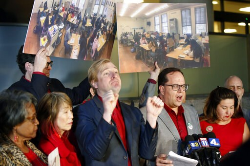 (AP Photo/Damian Dovarganes). United Teachers Los Angeles union president Alex Caputo-Pearl, third from right, surrounded by union negotiators speaks during a news conference at the Los Angeles Unified School District headquarters in Los Angeles Friday...