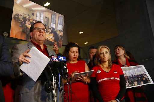 (AP Photo/Damian Dovarganes). United Teachers Los Angeles union president Alex Caputo-Pearl, left, holds a news conference at the Los Angeles Unified School District headquarters in Los Angeles Friday, Jan. 11, 2019. A massive teachers strike in Los An...