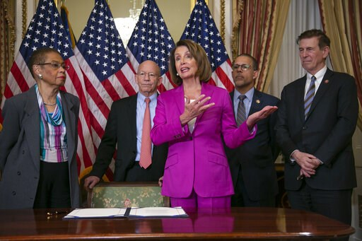 (AP Photo/J. Scott Applewhite). Speaker of the House Nancy Pelosi, D-Calif., talks to reporters after signing a House-passed a bill requiring that all government workers receive retroactive pay after the partial shutdown ends, at the Capitol in Washing...