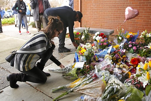 (AP Photo/Rich Pedroncelli). Mourners place flowers on a memorial outside the Davis Police Department for slain Davis Police Officer Natalie Corona, Friday, Jan. 11, 2019, in Davis, Calif. Corona, 22, who had been on the job only a few weeks was shot a...
