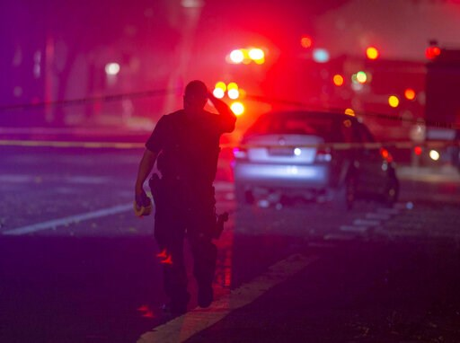(Jose Luis Villegas/The Sacramento Bee via AP). Davis Police closed the area near 5th and C streets in Davis, Calif., after a police officer was shot on Thursday, Jan. 10, 2019. A Davis police officer was shot Thursday night while responding to a traff...