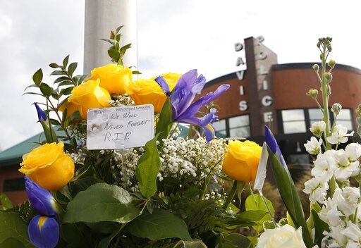 (AP Photo/Rich Pedroncelli). Flowers are seen on a memorial outside the Davis Police Department for slain Davis Police Officer Natalie Corona, Friday, Jan. 11, 2019, in Davis, Calif. Corona, 22, who had been on the job only a few weeks was shot and kil...
