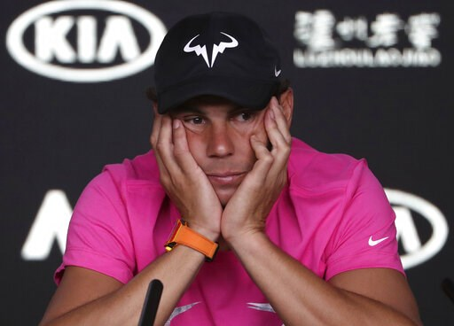 (AP Photo/Mark Schiefelbein). Spain's Rafael Nadal reacts during a press conference ahead of the Australian Open tennis championships in Melbourne, Australia, Saturday, Jan. 12, 2019.