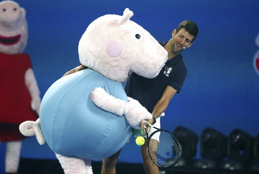 (AP Photo/Mark Schiefelbein). Serbia's Novak Djokovic and Peppa Pig combine to return a shot during Kids Tennis Day ahead of the Australian Open tennis championships in Melbourne, Australia, Saturday, Jan. 12, 2019.