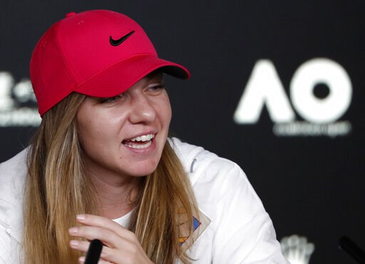 (AP Photo/Kin Cheung). Romania's Simona Halep answers a question during a press at the Australian Open tennis championships in Melbourne, Australia, Saturday, Jan. 12, 2019.