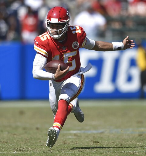 (AP Photo/Kelvin Kuo, File). FILE - In this Sept. 9, 2018, file photo, Kansas City Chiefs quarterback Patrick Mahomes runs against the Los Angeles Chargers during the second half of an NFL football game, in Carson, Calif. The Indianapolis Colts play th...