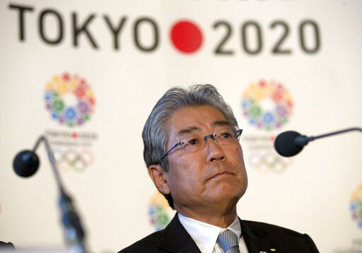 (AP Photo/Alastair Grant, File). FILE - This is a Thursday, Jan. 10, 2013 file photo of Tsunekazu Takeda, President of the Tokyo 2020 Olympic games bid, as he listens to a question from the media during their first international presentation of the Tok...