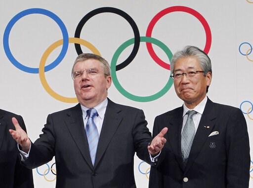 (AP Photo/Junji Kurokawa, File). FILE - This Nov. 20, 2013, file photo shows Japan Olympic Committee President Tsunekazu Takeda, right, and  International Olympic Committee (IOC) President Thomas Bach, left, following a press conference in Tokyo. Franc...