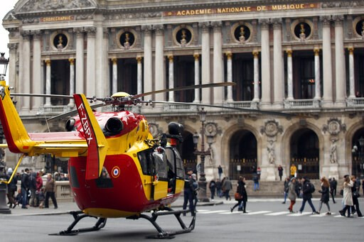 (AP Photo/Thibault Camus). A rescue helicopter stands ready to evacuate wounded people in front of the Paris Opera House following a gas leak explosion, France, Saturday, Jan. 12, 2019. A powerful explosion and fire apparently caused by a gas leak at a...